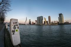 Wide angle view of Erasmus bridge and skyline of Rotterdam on a clear winter day. stock images