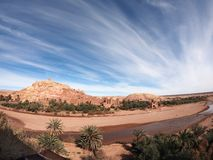 Wide angle view of the fortified village of Ait Ben Haddou with incredible clouds, near Ourzazate, in Morocco royalty free stock images