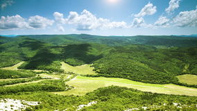 Wide Angle view green valley timelapse clouds stock video footage