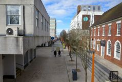 Wide Angle View of the High Street in Bracknell, England. Bracknell, England - March 11, 2018: A view of old and modern buildings along the High Street with Stock Photos