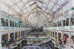 Wide-angle view of the interior of Stephen`s Green shopping cent. DUBLIN, IRELAND - April 14th, 2018: wide-angle view of the interior of Stephen`s Green shopping Royalty Free Stock Images