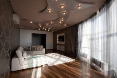 Wide-angle view of the living room. With design ceiling Royalty Free Stock Image