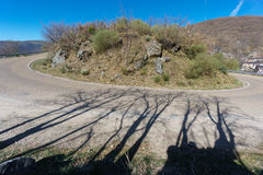 Wide angle view of mountain hairpin bend curved road Stock Images