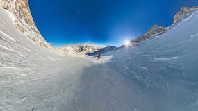 Wide-angle view of a mountain hiker to climb a mountain of snow Royalty Free Stock Photo
