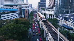 Free Wide Angle View Of Elevated Monorail Train, Passing Between Skyscrapers In Shimbashi Financial District. View From The Stock Photos - 103621673