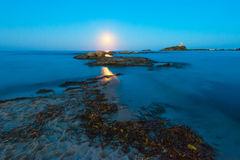 Free Wide Angle View Of Moon Over Seascape, Rocks And Lighthouse Stock Photo - 72739340