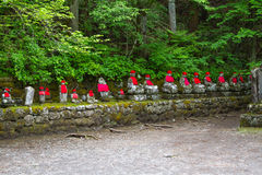 Wide Angle View Of Moss Covered Statues Of Jizo In Nikko, Japan. Front View Royalty Free Stock Photo
