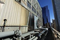Urban HVAC Air Contidioner Outdoor Unit Manhattan New-York. Wide angle view at an outdoor HVAC air conditioner unit located on a high-floor porch of a midtown Stock Photo