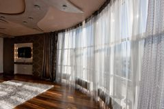 Wide-angle view of panoramic window with net curtain in modern l Royalty Free Stock Photos