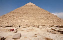 Wide angle view of the pyramid of Khafre. Unusual wide angle view of the pyramid of Khafre (Chephren) with its white polished limestone cap still intact at the Stock Photography