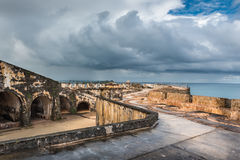 Wide angle view of second level of Castillo San Felipe del Morro. With stormy sky and sea in the background Stock Images