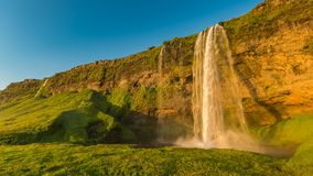 Wide angle view of Seljalandsfoss waterfall with rainbow in Iceland stock video footage
