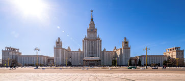 Wide angle view of spring sunny campus of Moscow University under blue sky Stock Photos