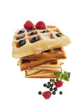 Wide angle view of stacked waffles with raspberries and bluberri Stock Photos
