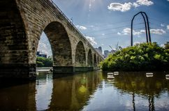 Wide angle view of Stone Arch Bridge in Minneapolis, MN. Stone Arch Bridge in downtown Minneapolis Minnesota, as seen from St. Anthony Main stock photos