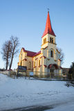 Wide angle view to the church with red roof Royalty Free Stock Image