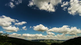 Wide Angle view to green mountains with timelapse clouds stock video footage