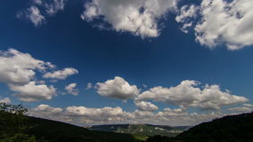 Wide Angle view to green mountains with timelapse clouds stock video