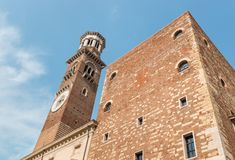 Wide angle view of Torre dei Lamberti in Verona, Italy. Wide angle view of Torre dei Lamberti in Verona against blue sky with copy space Royalty Free Stock Photography