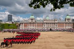 Wide angle view of Trooping the Colour parade at Horse Guards, London UK, with soldiers in red and black uniform and bearskins. Wide angle view of the Trooping stock photo
