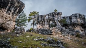Karstic unreal formation with holes in Cuenca. Wide angle view of the unreal karstic formations in the Majadas park, Cuenca, Spain Stock Image