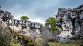 Karstic unreal formations with holes in Cuenca. Wide angle view of the unreal karstic formations in the Majadas park Royalty Free Stock Images