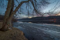Wide angle view of the vast St. Croix River on a frosty winter sunset / early evening - river separating Wisconsin and Minnesota -. Beautiful clouds and ice royalty free stock photos