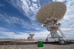 Wide angle view of the Very Large Array satellite communication center in New Mexico desert. Wide angle view of the Very Large Array satellite communication royalty free stock image