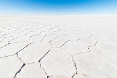 Wide angle view of the world famous Uyuni Salt Flat, among the most important travel destination in the Bolivian Andes. Close up o. F hexagonal shapes of the royalty free stock images