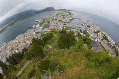 Wide angle wiew to the Alesund city on a cloudy summer day in Alesund, Norway. Royalty Free Stock Images