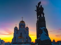 Wide angle view of soviet monument and church in Yekaterinburg at sunset royalty free stock photography