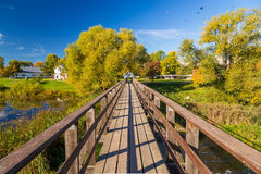 Wide angle wooden bridge over river Stock Photos