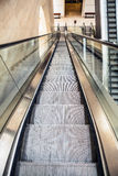 Wide angled view to perspective escalators stairway. Stock Images