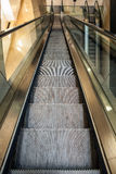 Wide angled view to perspective escalators stairway. Royalty Free Stock Photo