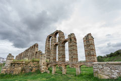 Wide Aqueduct of the Miracles in Merida, Spain, UNESCO. Ultra wide view of Aqueduct of the Miracles in Merida against stormy sky, Spain Stock Photography