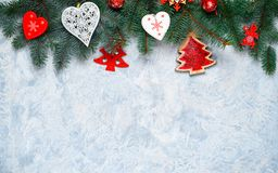 Christmas border isolated, composed of fresh fir branches and ornaments in red and white royalty free stock photo