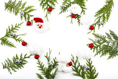Wide arch shaped Christmas border on white, composed of fresh fir branches with Santa Claus and ornaments Royalty Free Stock Photo