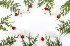 Wide arch shaped Christmas border on white, composed of fresh fir branches with Santa Claus and ornaments Royalty Free Stock Images