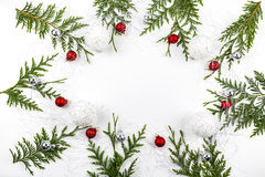 Wide arch shaped Christmas border on white, composed of fresh fir branches with Santa Claus and ornaments Stock Images