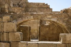 Wide arches in the passage at excavations in the Nabatean city of Mamshit. Israel, the first century BC Royalty Free Stock Images