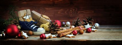 Wide background for St. Nicholas Day, Children`s shoe with sweet stock photography