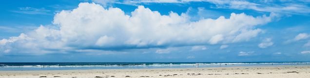 Wide banner of a surfer beach in Brittany with a big cloud over the beach stock images