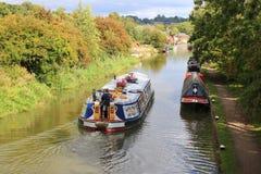 Wide beam narrowboat cruising canal royalty free stock image