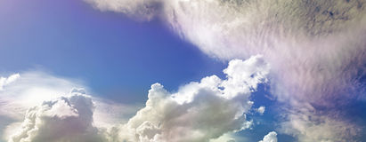 Wide Beautiful Blue Sky. Wide blue sky and random clouds with pink tinges Royalty Free Stock Photos