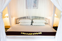 Wide bed under bed curtains Stock Photo