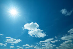 Wide blue skies and sun Royalty Free Stock Photos