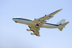 Wide-bodied jet airliner. In the sky taken from below Royalty Free Stock Photo