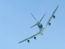 Wide-body airliner flying. Very large wide-body airliner flying, seen from behind Royalty Free Stock Photography