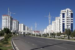 Wide boulevard with some new buildings. Ashkhabad. Turkmenistan. Wide boulevard with some new buildings. Ashkhabad, Turkmenistan stock photo