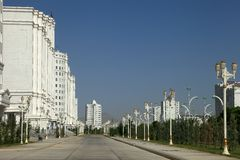 Wide boulevard with some new buildings. Ashkhabad. Turkmenistan. Royalty Free Stock Photos